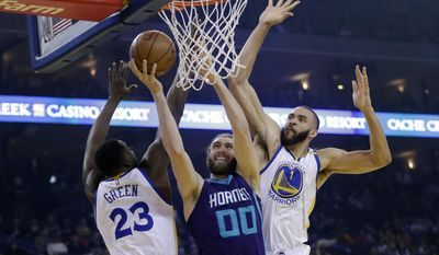 Charlotte Hornets' Spencer Hawes (00) drives to the basket as Golden State Warriors' Draymond Green (23) and JaVale McGee (1) defend during the first half of an NBA basketball game Wednesday, Feb. 1, 2017, in Oakland, Calif. (AP Photo/Marcio Jose Sanchez)