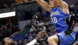 Orlando Magic's Aaron Gordon, right, dunks as Minnesota Timberwolves' Shabazz Muhammad looks on during the second half of an NBA basketball game Monday, Jan. 30, 2017, in Minneapolis. The Timberwolves won 111-105 in overtime. (AP Photo/Jim Mone)