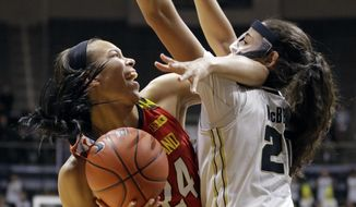 Maryland forward Stephanie Jones (24) gets tangled up with Purdue forward Dominique McBryde (20) during the first half of an NCAA college basketball game in West Lafayette, Ind., Thursday, Feb. 2, 2017. (AP Photo/Michael Conroy) **FILE**