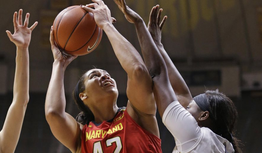 Maryland center Brionna Jones (42) shoots over Purdue guard Andreona Keys (10) during the first half of an NCAA college basketball game in West Lafayette, Ind., Thursday, Feb. 2, 2017. (AP Photo/Michael Conroy)