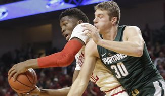 Nebraska's Jordy Tshimanga (32) grabs a rebound in front of Michigan State's Matt Van Dyk (30) during the first half of an NCAA college basketball game in Lincoln, Neb., Thursday, Feb. 2, 2017. (AP Photo/Nati Harnik)