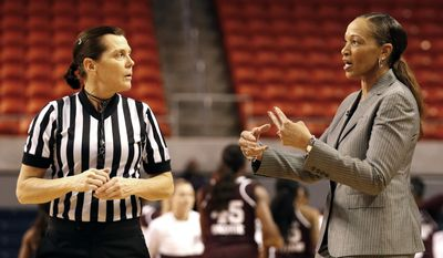 Auburn head coach Terri Williams-Flournoy, right, talks with an official during the first half of an NCAA college basketball game against Mississippi State, Thursday, Feb. 2, 2017, in Auburn, Ala. (AP Photo/Butch Dill)