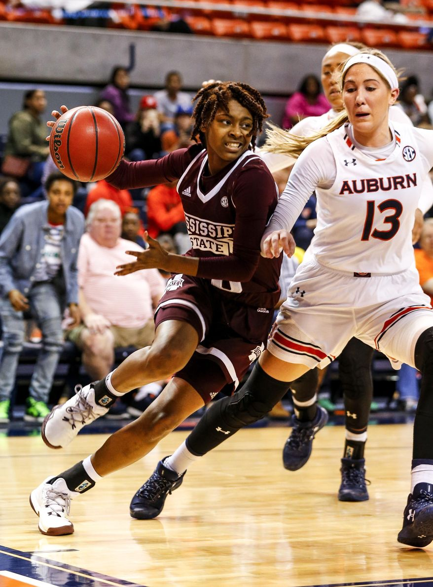Mississippi State guard Jazzmun Holmes (10) drives the baseline around Auburn guard/forward Katie Frerking (13) during the first half of an NCAA college basketball game, Thursday, Feb. 2, 2017, in Auburn, Ala. (AP Photo/Butch Dill)