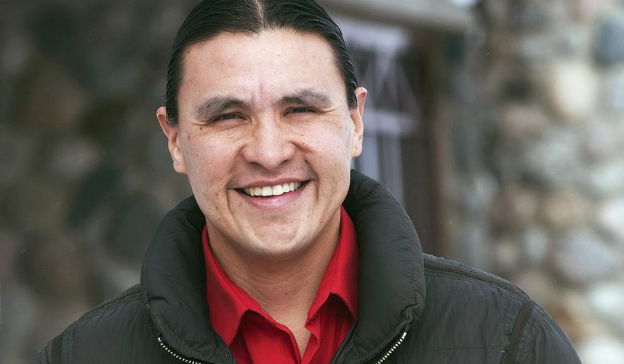 FILE - In this Feb. 6, 2014 file photo, Chase Iron Eyes, an attorney and American Indian activist on the Standing Rock Reservation, is seen in Fort Yates, N.D. Iron Eyes, who unsuccessfully ran for Congress last fall, is among Dakota Access pipeline opponents who were arrested Wednesday, Feb. 1, 2017, in North Dakota after setting up camp on private land. (AP Photo/Kevin Cederstrom, File)