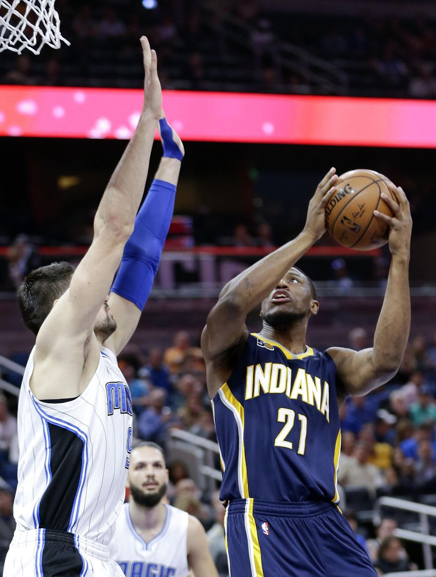 Indiana Pacers' Thaddeus Young (21) takes a shot over Orlando Magic's Nikola Vucevic, left, during the first half of an NBA basketball game, Wednesday, Feb. 1, 2017, in Orlando, Fla. (AP Photo/John Raoux)