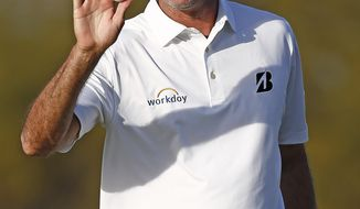 Matt Kuchar waves to the crowd after sinking a birdie putt on the 15th hole during the first round of the Waste Management Phoenix Open golf tournament Thursday, Feb. 2, 2017, in Scottsdale, Ariz. (AP Photo/Ross D. Franklin)n