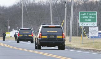 More State Troopers arrive on scene as all Delaware prisons went on lockdown late Wednesday due to a hostage situation unfolding Wednesday, Feb. 1, 2017,   at the James T. Vaughn Correctional Center in Smyrna, Del. Geoffrey Klopp, president of the Correctional Officers Association of Delaware, said he had been told by the Department of Correction commissioner that prison guards had been taken hostage.  (Suchat Pederson/The Wilmington News-Journal via AP)