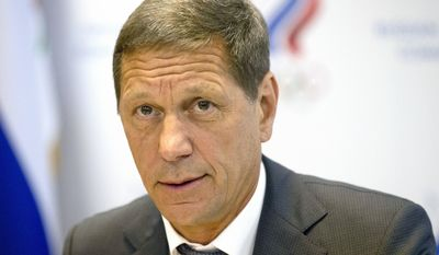"""FILE- In this Wednesday, July 20, 2016 file photo Russian Olympic Committee president Alexander Zhukov opens the meeting of Russia's Olympic Committee in Moscow, Russia. Russian officials say none of their athletes have returned Olympic medals after retests of their samples revealed they had doped. Russian Olympic Committee president Alexander Zhukov says his organization, which would usually handle medal transfers, hasn't received any, calling it """"not an easy process."""" (AP Photo/Alexander Zemlianichenko, file)"""