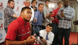Highly touted quarterback recruit Tua Tagovailoa speaks to the media during a news conference announcing the recruiting class for the University of Alabama in Tuscaloosa, Ala., Wednesday, Feb. 1, 2017. Tagovailoa is one of the players who took advantage of early enrollment. (Gary Cosby Jr./The Tuscaloosa News via AP)