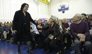 U.S. Supreme Court Justice Sonia Sotomayor, standing, circulates among the crowd while speaking to students and other invitees during the Thomas J. Volpe lecture series at St.Francis College in Brooklyn Heights, Thursday, Feb. 2, 2017, in New York. (AP Photo/Kathy Willens)