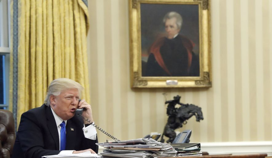 In this Jan. 28, 2017, file photo, U.S. President Donald Trump speaks on the phone with Prime Minister of Australia Malcolm Turnbull in the Oval Office of the White House in Washington. Mr. Trump discussed the ongoing Ukraine-Russia border conflict with Ukrainian President Petro Poroshenko in a Feb. 4, 2017 phone call, according to the White House. (AP Photo/Alex Brandon) **FILE**