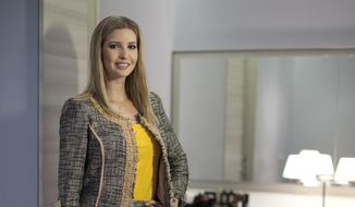 In this March 6, 2015 file photo, Ivanka Trump models an outfit following an interview to promote her clothing line in Toronto. Nordstrom said Thursday, Feb. 2, 2017,  it will stop selling Ivanka Trump clothing and accessories. The Seattle-based department store chain said the decision was based on the sales performance of the first daughter's brand. (Pawel Dwulit/The Canadian Press via AP)