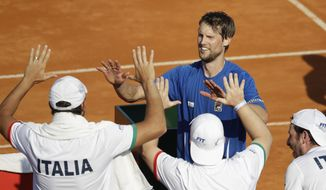 Italy's Andreas Seppi celebrates his victory over Argentina's Carlos Berlocq after a Davis Cup first round tennis match in Buenos Aires, Argentina, Friday, Feb. 3, 2017. (AP Photo/Natacha Pisarenko)