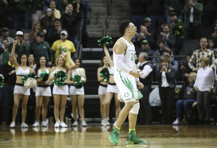 Oregon's Dillon Brooks celebrates with Duck fans after sinking a 3-point shot to give Oregon the lead over Arizona State in the closing moments of an NCAA college basketball game Thursday, Feb. 2, 2017, in Eugene, Ore. (AP Photo/Chris Pietsch)