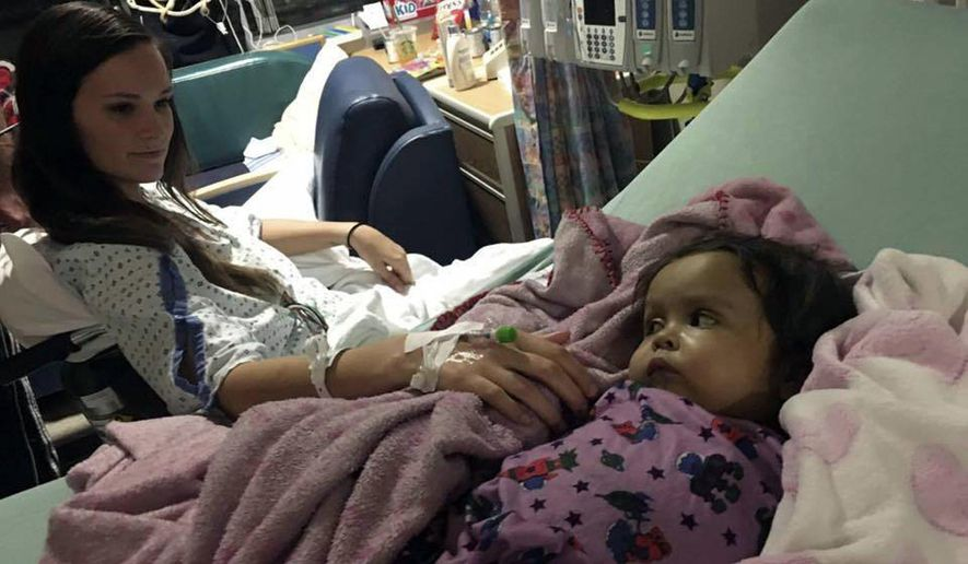Kiersten Miles, left, greets Talia Rosko after a surgery Jan. 14, 2017, at Children's Hospital of Philadelphia where Miles donated a portion of her liver to the girl. Miles had only known the Rosko family, of Jackson, for three weeks when she learned that baby Talia had a serious disease that could turn fatal if she didn't receive a liver transplant. (Farra Rosko via AP)