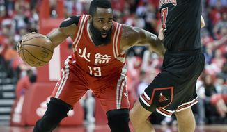 Houston Rockets guard James Harden (13) dribbles around Chicago Bulls guard Michael Carter-Williams during the first half of an NBA basketball game, Friday, Feb. 3, 2017, in Houston. (AP Photo/Eric Christian Smith)