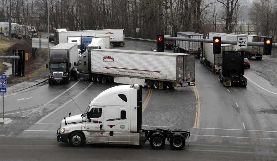 CORRECTS FROM INTERSTATE 5 TO INTERSTATE 84- A handful of entangled semi trucks block a stretch of an icy road just off Interstate 84 in Troutdale, Ore., Friday, Feb. 3, 2017. Freezing rain has caused many crashes in the Portland and Columbia River Gorge areas. (AP Photo/Don Ryan)