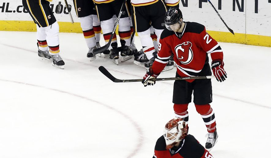 Brodie s career-high 4 assists help Flames blaze past Devils ... 63809a7a1