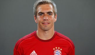 FILE - In this July 16, 2015 file photo, Bayern's Philipp Lahm poses during an official photo shooting in Munich, Germany. After overcoming an injury scare Monday, Philipp Lahm is all set to make his 500th appearance for Bayern Munich when the side plays Schalke at home in the Bundesliga on Saturday. Alarm bells where ringing when Lahm limped off after getting a knock to his knee in Monday's training session, but the club's relief when he was given the all-clear shortly afterward indicates the importance the 33-year-old still holds.   (AP Photo/Matthias Schrader,file)
