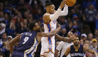 Oklahoma City Thunder guard Russell Westbrook (0) passes between Memphis Grizzlies guard Tony Allen (9) and guard Mike Conley (11) during the second quarter of an NBA basketball game in Oklahoma City, Friday, Feb. 3, 2017. (AP Photo/Sue Ogrocki)