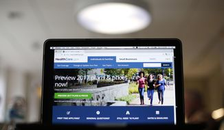 FILE - In this Oct. 24, 2016 file photo, the HealthCare.gov 2017 web site home page as seen in Washington. The government says about 9.2 million people signed up for coverage this year through HealthCare.gov, the health insurance website serving most states. (AP Photo/Pablo Martinez Monsivais, File)