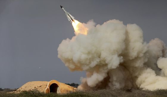 In this Dec. 29, 2016, photo, released by the semi-official Iranian Students News Agency (ISNA), a long-range S-200 missile is fired in a military drill in the port city of Bushehr, on the northern coast of Persian Gulf, Iran. (Amir Kholousi, ISNA via AP) **FILE**