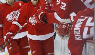Detroit Red Wings defenseman Danny DeKeyser celebrates his goal against the New York Islanders during the third period of an NHL hockey game Friday, Feb. 3, 2017, in Detroit. (AP Photo/Paul Sancya)