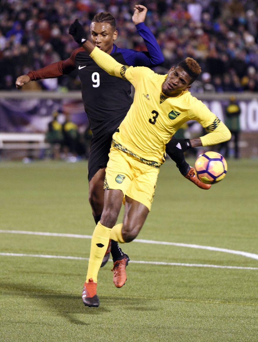 United States' Juan Agudelo (9) is defended by Jamaica's Damion Lowe (3) during first half of a friendly soccer match  Friday, Feb. 3, 2017, in Chattanooga, Tenn. (AP Photo/Billy Weeks)