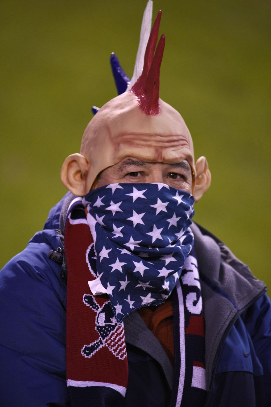 Al Palacio cheers for the United States during first half of the team's friendly soccer match with Jamaica on Friday, Feb. 3, 2017, Chattanooga, Tenn. (AP Photo/Billy Weeks)