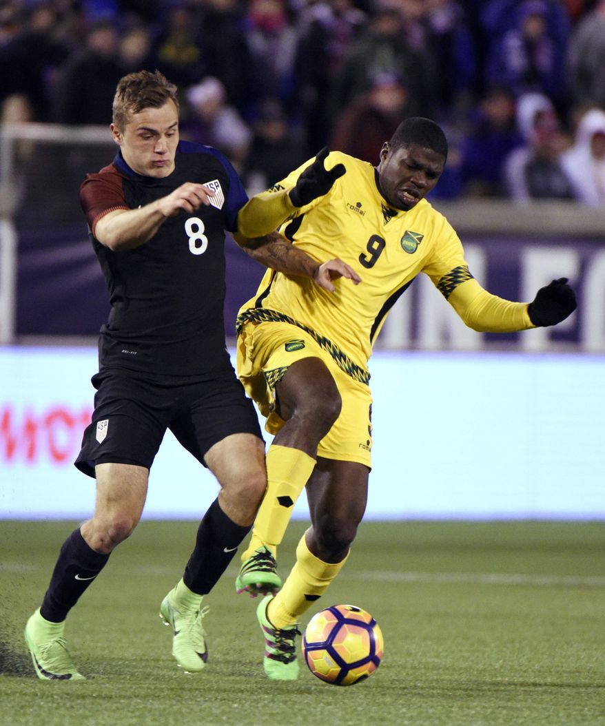 United States' Jordan Morris (8) is defended by Jamaica's Ewan Grandson (9) during second half of a friendly soccer match Friday, Feb. 3, 2017, in Chattanooga, Tenn. (AP Photo/Billy Weeks)