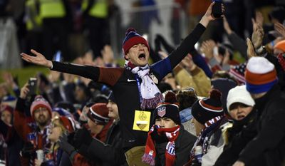 James Polk of Nashville, Tenn., cheers for the United States during first half of a friendly soccer match against  Jamaica on Friday, Feb. 3, 2017, in Chattanooga, Tenn. (AP Photo/Billy Weeks)