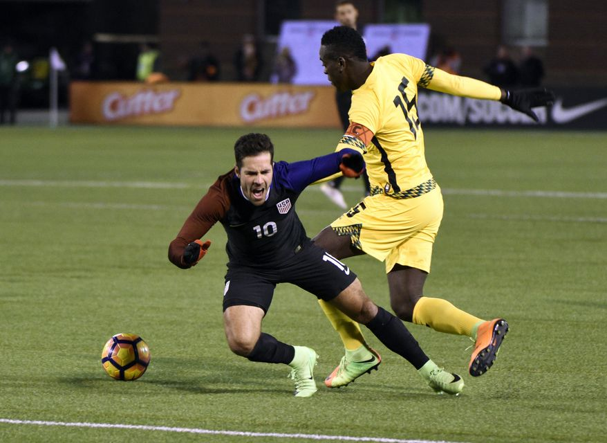 United States' Benny Feihaber (10) defends Jamaica's Je-Vaughn Watson(15) during first half of a friendly soccer match  Friday, Feb. 3, 2017, in Chattanooga, Tenn. (AP Photo/Billy Weeks)