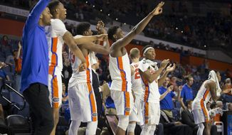The Florida bench celebrates a 3-pointer by the team during the second half of an NCAA college basketball game against Missouri in Gainesville, Fla., Thursday, Feb. 2, 2017. Florida won 93-54. (AP Photo/Ron Irby)