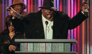 FILE - In this Dec. 6, 1995, file photo, The Notorious B.I.G., who won rap artist and rap single of the year, clutches his awards at the podium during the annual Billboard Music Awards in New York. The late rapper's wife announced on Feb. 3, 2017, that she is releasing an album of duets with B.I.G. (AP Photo/Mark Lennihan, File)