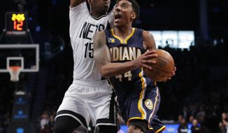 Indiana Pacers' Jeff Teague (44) drives to the basket against Brooklyn Nets' Isaiah Whitehead (15) during the first half of an NBA basketball game, Friday, Feb. 3, 2017, in New York. (AP Photo/Andres Kudacki)