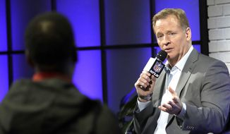 NFL Commissioner Roger Goodell, right, answers a question from a fan about marijuana use during a fan forum for the NFL Super Bowl 51 football game Friday, Feb. 3, 2017, in Houston. (AP Photo/David J. Phillip)