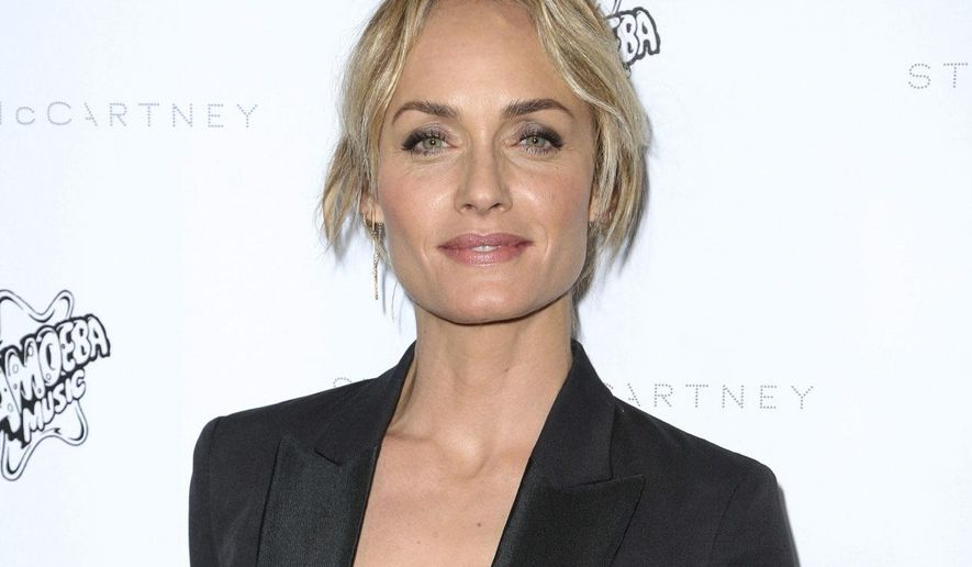 FILE - This Jan. 12, 2016 file photo shows Sierra Club Ambassador, model, actress and Oklahoma native Amber Valletta at the Stella McCartney Autumn 2016 Presentation in Los Angeles. Valletta authored a passionate op-ed piece released Friday, Feb. 3, 2017, on Glamour.com, opposing Oklahoma Attorney General Scott Pruitt's nomination to lead the Environmental Protection Agency.  (Photo by Rich Fury/Invision/AP, File)