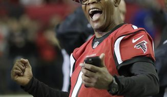 FILE - In this Sunday, Jan. 22, 2017, file photo, actor Samuel L. Jackson has some fun before the NFL football NFC championship game between the Green Bay Packers and the Atlanta Falcons in Atlanta. With the Falcons on the verge of their first-ever NFL championship, many celebrities based in the city are showing their hometown team major support. Usher, Samuel L. Jackson and Ludacris have been spotted cheering from the sidelines at home games along with showing appreciation through social media with the team's slogan #riseup. (AP Photo/Mark Humphrey, File_