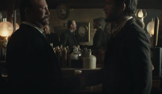 This photo provided by Budweiser shows a scene from the company's spot for Super Bowl 51, between the New England Patriots and Atlanta Falcons, Sunday, Feb. 5, 2017. The scene depicts when Anheuser-Busch co-founder Adolphus Busch, right, after traveling by boat from Germany, met fellow immigrant Eberhard Anheuser. (Budweiser via AP)