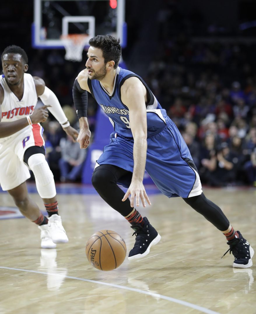 Minnesota Timberwolves guard Ricky Rubio drives around Detroit Pistons guard Reggie Jackson during the first half of an NBA basketball game, Friday, Feb. 3, 2017, in Auburn Hills, Mich. (AP Photo/Carlos Osorio)