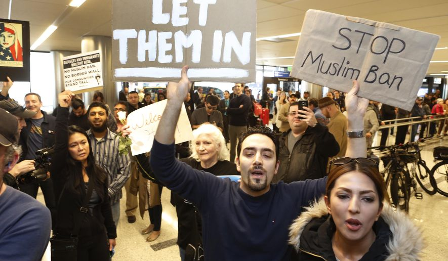 Supporters cheer as an Iranian citizen with a valid U.S. visa arrives at Los Angeles International Airport Thursday, Feb. 2, 2017. An Iranian man turned away from Los Angeles International Airport under President Donald Trump's executive order barring people from seven Muslim-majority nations has arrived back in the U.S. under a federal judge's order. A federal judge on Sunday ordered U.S. authorities bring him back. He was among hundreds detained or turned away from airports after the ban was implemented. (AP Photo/Damian Dovarganes)