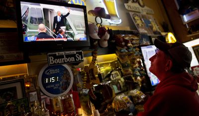 """ADVANCE FOR USE TUESDAY, FEB. 7, 2017 AND THEREAFTER-Robbo Coleman watches a live broadcast of former President Barack Obama waving goodbye during the inauguration of President Donald Trump at the Sawmill Saloon in Prairie du Chien, Wis., Friday, Jan. 20, 2017. Coleman voted for Obama four years ago. This time, he voted for Trump. To explain why, he held up an ink pen, wrapped in plastic with """"Made in China"""" printed in block letters. """"I don't see why we can't make pens in Prairie du Chien, or in Louisville, Ky., or in Alabama, or wherever,"""" he said. (AP Photo/David Goldman)"""