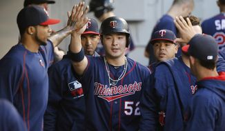 FILE - In this May 6, 2016 file photo, Minnesota Twins designated hitter Byung Ho Park celebrates in the dugout after scoring on Kurt Suzuki's single off a pitch from Chicago White Sox starting pitcher Mat Latos during the second inning of a baseball game in Chicago. The Twins have designated Byung Ho Park for assignment following a disappointing major league debut as a designated hitter. The move was made on Friday, Feb. 3, 2017  to clear space on the 40-man roster for right-handed reliever Matt Belisle, who finalized a $2.05 million, one-year contract after posting a career-best 1.76 ERA last season for Washington. (AP Photo/Charles Rex Arbogast)