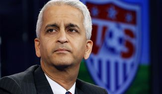 FILE - This Oct. 10, 2014, file photo shows Sunil Gulati, president of the United States Soccer Federation, during a press conference in Bristol, Conn. An emphasis on player-driven leadership has brought encouraging signs in talks for a labor contract between the women's national team and the U.S. Soccer Federation, according to defender Becky Sauerbrunn.  AP Photo/Elise Amendola, File)
