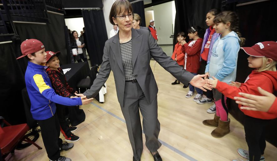 Stanford coach Tara VanDerveer is greeted by fans as she enters the court before the team's NCAA college basketball game against Southern California on Friday, Feb. 3, 2017, in Stanford, Calif. (AP Photo/Marcio Jose Sanchez)