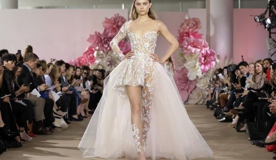 Bridal Fashion Week in New York reveals the latest trends for brides and their wedding parties. (AP Photo/Richard Drew