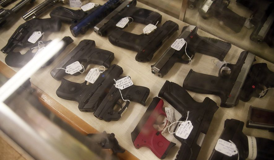 Guns are displayed for sale at the Ohio Supply & Tool in Wadsworth, Ohio, on Jan. 26, 2017. (Associated Press) **FILE**