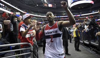 Washington Wizards guard John Wall leaves the court and gestures after the team's NBA basketball game against the New Orleans Pelicans, Saturday, Feb. 4, 2017, in Washington. The Wizards won 105-91. (AP Photo/Nick Wass)