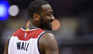 Washington Wizards guard John Wall smiles during the second half of the team's NBA basketball game against the New Orleans Pelicans, Saturday, Feb. 4, 2017, in Washington. The Wizards won 105-91. (AP Photo/Nick Wass)