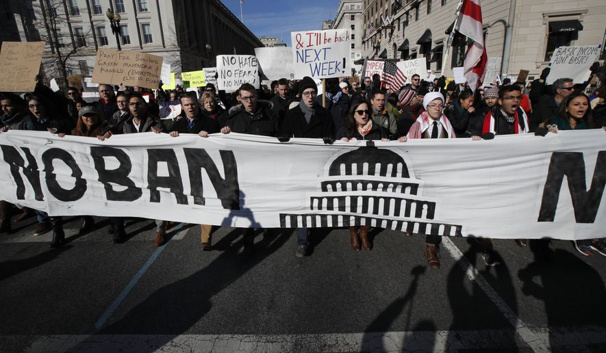Protesters march from Lafayette Park near the White House in Washington, Saturday, Feb. 4, 2017, during a rally protesting the immigration policies of President Donald Trump.   (AP Photo/Manuel Balce Ceneta)